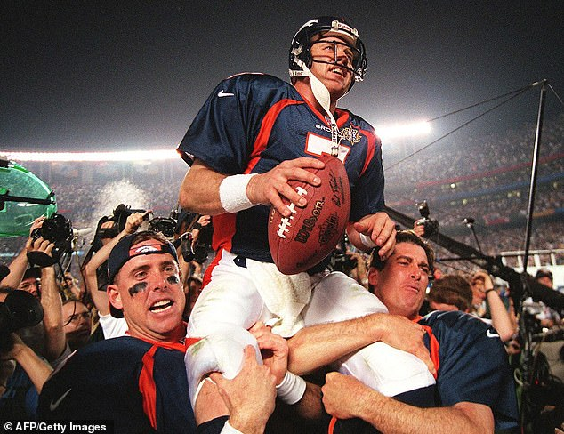 Both of Elway's ring fingers were bent in towards his palm, unable to be straightened. Pictured: Elway (center) is carried by teammates Ed McCaffrey (left) and Bubby Brister (right) after the Denver Broncos defeated the Green Bay Packers to win Super Bowl XXXII in January 1998