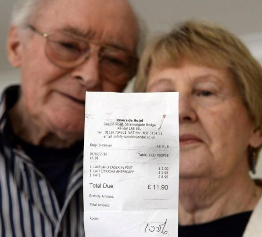 Robert and Phyllis holding the receipt