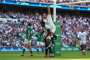 Maro Itoje celebrates with teammate Jamie George after scoring a try.