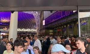 Passengers at King's Cross station in London