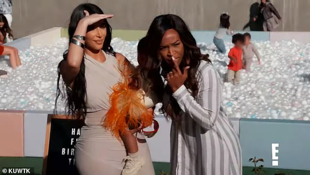 Yikes:Kim says: 'Oh my God, Tristan's here' while footage of her looking shocked is shown; she is holding her daughter Chicago while standing with pal Malika Haqq