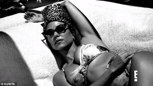 Holiday: Kourtney lounged in her high-waist bikini and a leopard-printed headpiece
