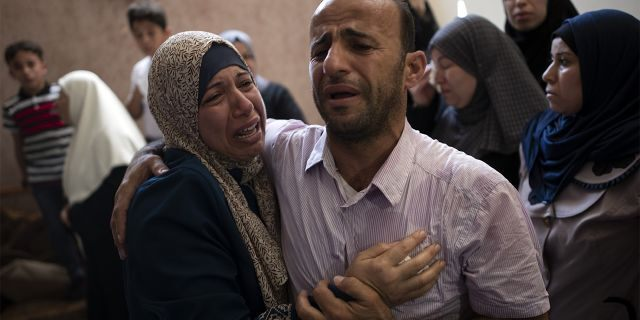 Relatives mourning the death of the 14-year-old Palestinian teenager Saturday.
