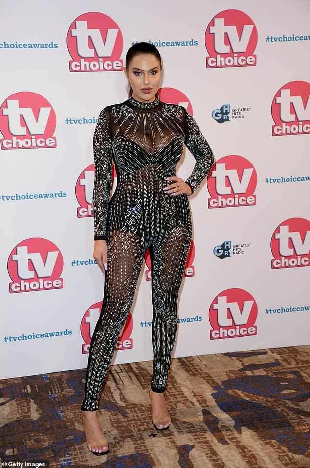All eyes on her: The Love Island star, 29, slipped into a semi-sheer bejewelled catsuit, which hugged her hourglass curves