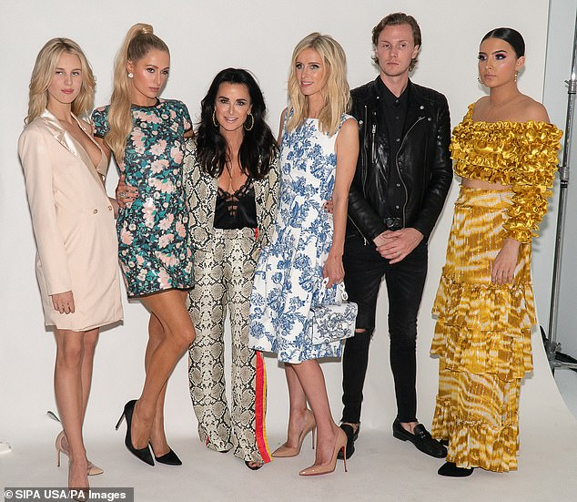 Family fun: On Saturday he posed with (from left) Tessa,  Paris Hilton, Kyle Richards, Nicky Hilton, and Sofia Umansy backstage at the Kyle & Shahida Runway Show during New York Fashion Week at Pier 59 Studios in New York