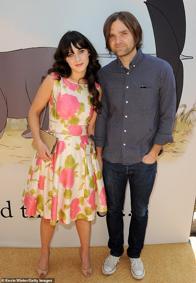 First husband: Before converting to Judaism to wed the You Can't Win producer, Zooey was married to Death Cab for Cutie frontman Ben Gibbons (R) for two years until their 2012 divorce (pictured in 2011)