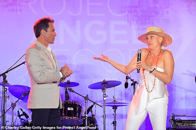Presenting: Nicollette later removed her shades and her blazer as she joined Eric McCormack onstage