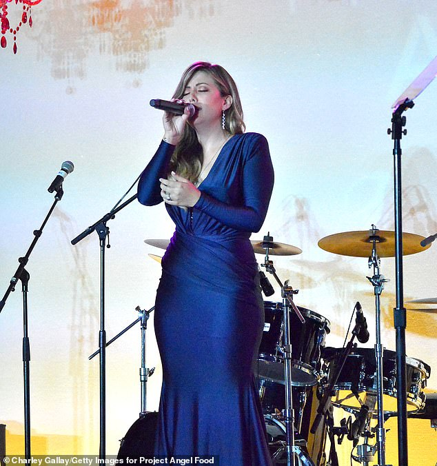 Crooner: Meanwhile, The Voice 16 champ Maelyn Jarmon belted a tune while clad in a plunging navy-blue gown