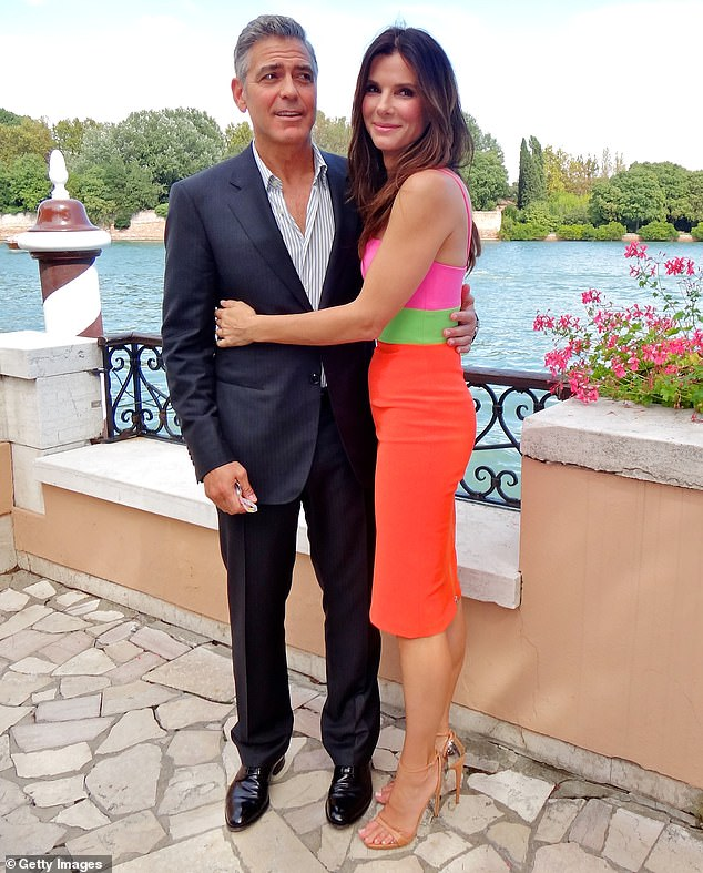 They loved the movie: Here Clooney and Bullock are seen in Veniceat the Hotel Cipriani in 2013; the film was a massive hit
