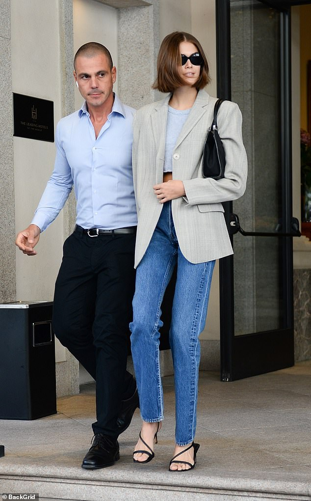 Stroll:The daughter of supermodel Cindy Crawford, 18, flashed her toned midriff in a dove grey crop-top, paired with an 80s-inspired pinstripe blazer