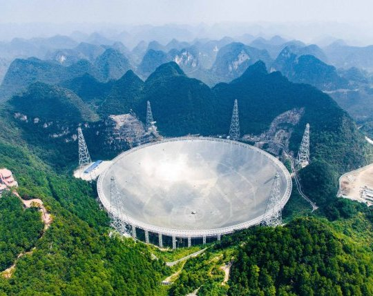 "(161208) -- BEIJING, Dec. 8, 2016 (Xinhua) -- Photo taken on Sept. 24, 2016 shows the 500-meter Aperture Spherical Telescope (FAST) in Pingtang County, southwest China's Guizhou Province. The FAST, world's largest radio telescope, measuring 500 meters in diameter, was completed and put into use on Sept. 25. FAST, also called ""China's eye of heaven,"" is the world's largest and most sensitive radio telescope, and China holds the intellectual property rights to it. Work on the nearly 1.2-billion-yuan (180 million U.S. dollars) project started in 2011, and the installation of the telescope's main structure -- a 4,450-panel reflector as large as 30 football pitches -- was finished in early July this year. FAST's tasks include survey of neutral hydrogen in the space, observation of pulsars as well as spacecraft tracking and communications. China achieved major breakthroughs in scientific and technological development in 2016. (Xinhua/Liu Xu) (ry) (Photo by Xinhua/Sipa USA)"