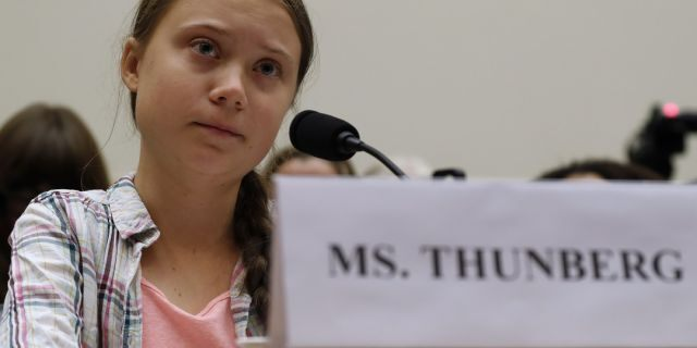 Youth climate change activist Greta Thunberg, left, speaking at a House Foreign Affairs Committee subcommittee hearing on climate change Wednesday. (AP Photo/Jacquelyn Martin)