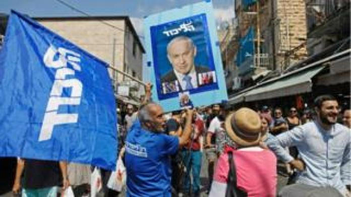Supporters of Israeli Prime Minister Benjamin Netanyahu march at the Mahane Yehuda Market in Jerusalem on 13 September, 2019.