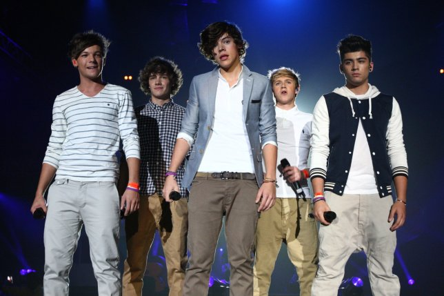 LONDON, ENGLAND - OCTOBER 09: Harry Styles, Zain Malik, Louis Tomlinson, Liam Payne and Niall Horan of One Direction perform at the BBC Teen Awards at Wembley arena on October 9, 2011 in London, United Kingdom. (Photo by Dave Hogan/Getty Images)