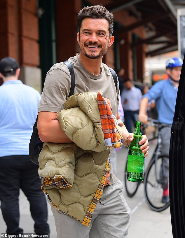 Upbeat:Orlando Bloom was in high spirits as he greeted fans in New York City on Thursday afternoon while promoting Amazon series Carnival Row
