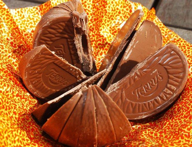A Terry's chocolate orange, broken into segments.