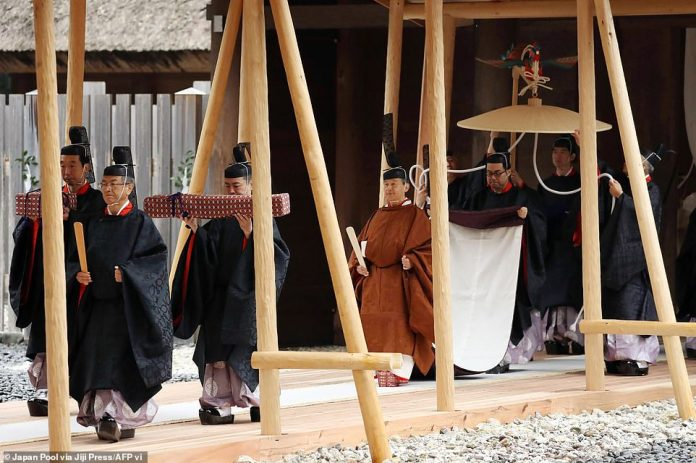 Japan's Emperor Naruhito (centre) attends a ritual at the Ise Grand Shrine of Geku with Empress Masako (not pictured), in Ise, Mie Prefecture, Japan, 22 November 2019