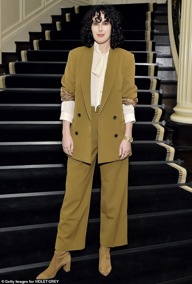 Androgynous chic: Rumer Willis cut an androgynous chic look in mustard Wednesday at a private dinner in LA, celebrating the launch of Violet Grey x Victoria Beckham