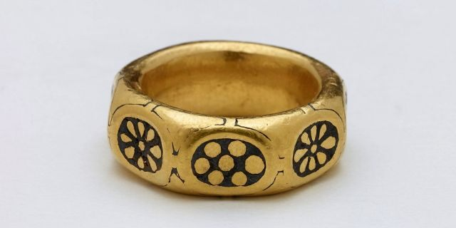This undated handout photo provided by the British Museum shows a gold ring from the ninth century which was part of a million-dollar Viking hoard that metal detectorists George Powell and Layton Davies have been convicted of stealing. (British Museum via AP)