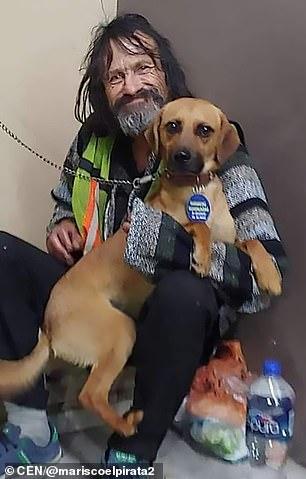 Raul holding his dog Solovino