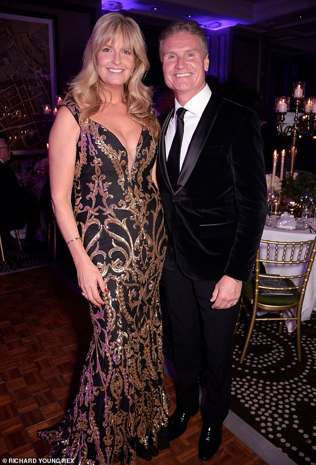 Racy: As well as wowing on her own, TV presenter Penny also posed happily with stars including former Formula 1 driver David Coulthard, 48