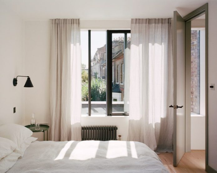 Corner House by 31/44 Architects bedroom