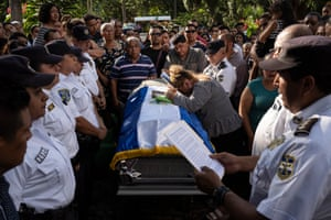 The funeral of Hugo, a police officer, in Santa Ana. His body was found on the street in Chalchuapa. He is survived by his wife and two children, a boy and girl.
