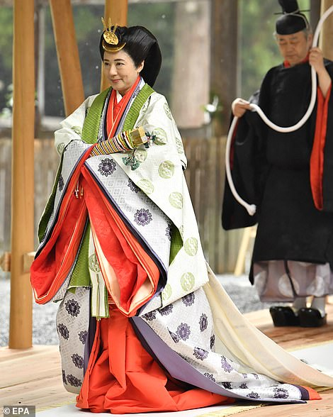Japan's Empress Masako (left) attends a ritual at the Ise Grand Shrine of Geku with Emperor Naruhito (not pictured), in Ise, Mie Prefecture, Japan, 22 November 2019