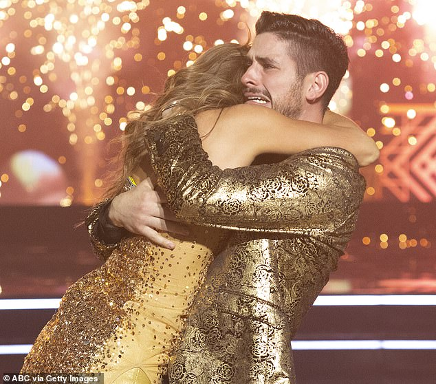 Big hug: Hannah jumped into Alan's arms as they were named the winners