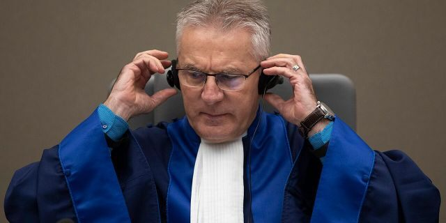 Presiding ICC judge Robert Fremr prepares to read the sentence for Congolese militia commander Bosco Ntaganda in the courtroom of the International Criminal Court in The Hague, Netherlands, Thursday, Nov. 7, 2019. (AP Photo/Peter Dejong, Pool)