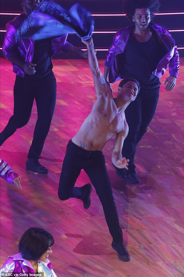 Shirt off: Pro dancer Sasha tossed his shirt off during the routine