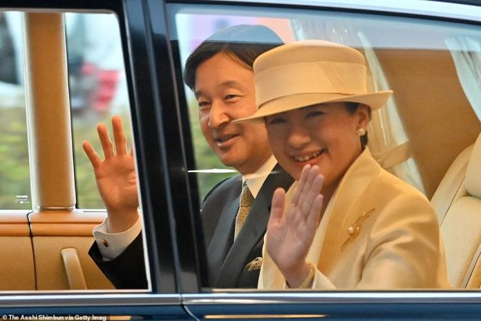 Emperor Naruhito and Empress Masako wave to well-wishers on arrival to Kintetsu Ujiyamada Station on November 21, 2019 in Ise, Mie, Japan