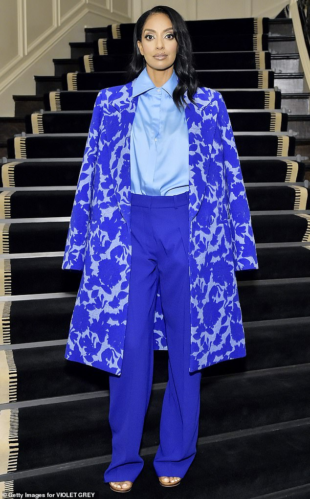 The blues: Azie Tesfai put on a chic display in a blue floral-print top coat draped over her shoulders with a powder blue satin shirt and royal blue high-waisted trousers