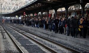 Commuters wait at Gare de l'Est train station in Paris