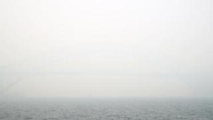 Sydney Harbour Bridge obscured by grey smoke