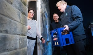 Prime minister Boris Johnson delivers milk to Debbie Monaghan in Guiseley, Leeds, ahead of Thursday's General Election.