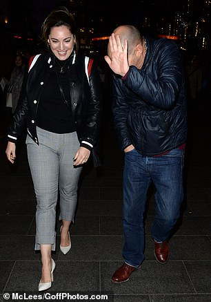 Pals: But they were back together and in high spirits as they departed Capital Radio Studios, some seventeen years after closing the doors at Old Ford Lock