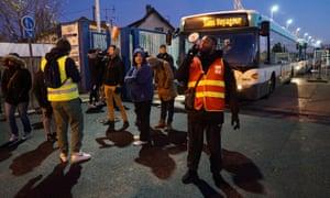 Union members and employees of the Paris transport network RATP block a bus depot in Les-Pavillons-sous-Bois near Paris