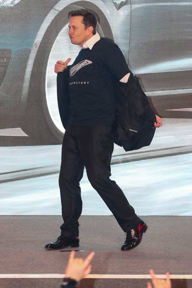 """Tesla CEO Elon Musk dances during the Tesla China-made Model 3 Delivery Ceremony in Shanghai. - Tesla CEO Elon Musk presented the first batch of made-in-China cars to ordinary buyers on January 7, 2020 in a milestone for the company's new Shanghai """"giga-factory"""", but which comes as sales decelerate in the world's largest electric-vehicle market. (Photo by STR / AFP) / China OUT (Photo by STR/AFP via Getty Images)"""