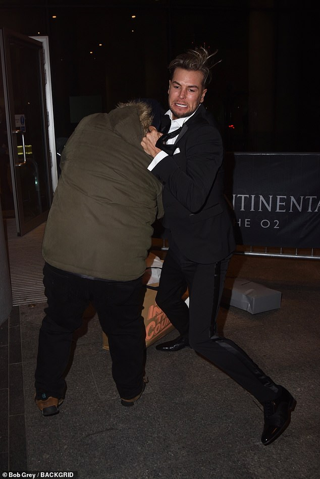 Chris Hughes found himself embroiled in a violent-looking altercation as he exited London 's O2 Arena on Tuesday night following the National Television Awards
