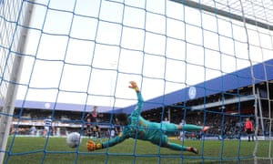 QPR's Liam Kelly saves a penalty from Patrick Bamford, awarded for his own challenge on the Leeds forward