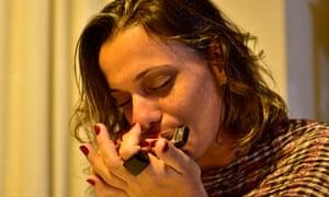 Woman playing a harmonica