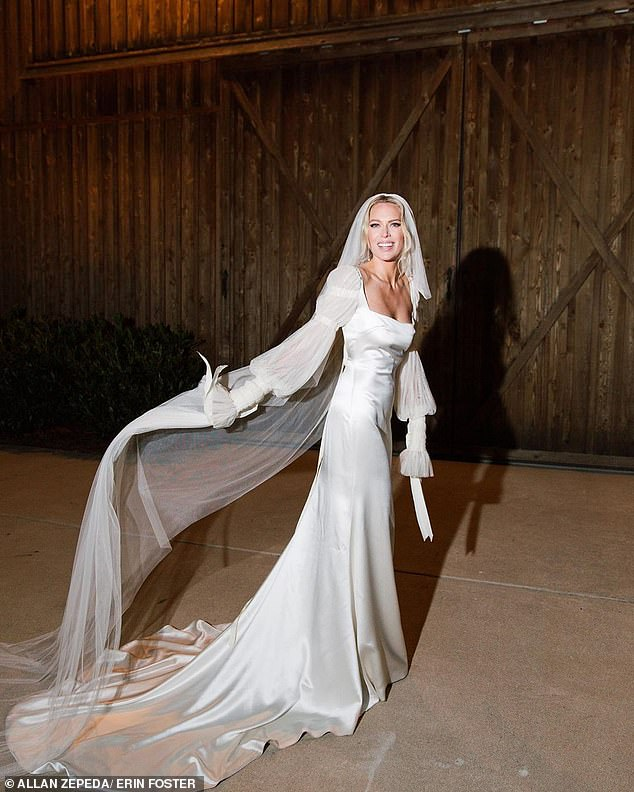 All dressed in white! Foster looked like a princess playing with her long veil
