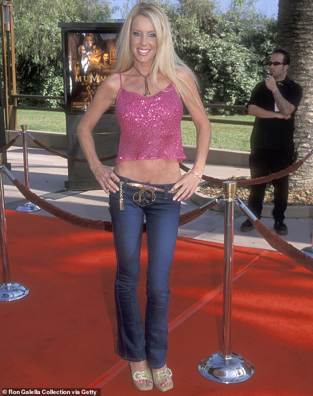 Better days:Playboy model Heather Elizabeth Parkhurst almost lost one of her arms when her two pitbulls attacked her at home in a frightening incident over the weekend. Seen in 2001