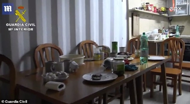 Six Ukrainians were found inside when Spanish Police entered. Above is their kitchen