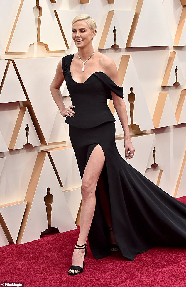Leggy display: Theron was nominated for a Best Actress Oscar at the 92nd Academy Awards for her role in Bombshell