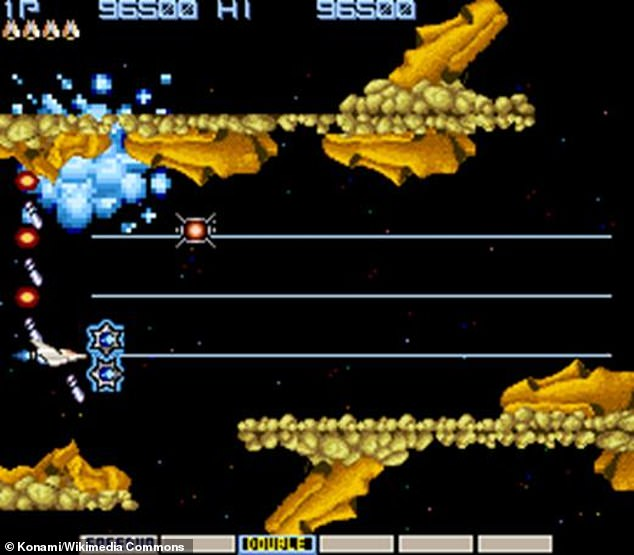 A shot of the original Gradius video game, for whichHashimoto developed the Konami Code.The player's ship, the Vic Viper, left, exchanges shots with enemy Moai
