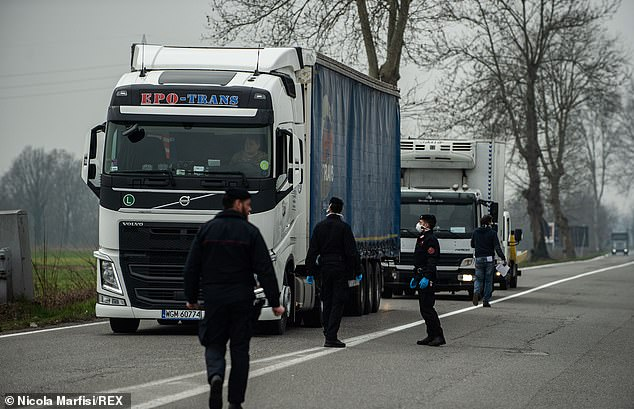 A lorry is stopped at an army andCarabinieri checkpoint on the border of the red zone nearCasalpusterlengo yesterday