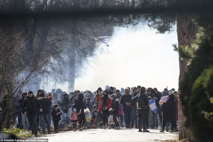 Turkish border guards stood aside Friday morning in Edirne and allowed migrants to rush the Greek side of the border, where they were met with tear gas