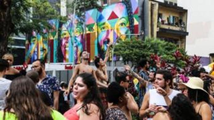Revellers dance in the streets